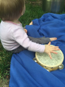 baby with tamborine