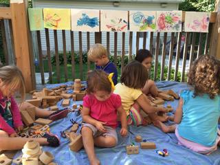 children with outdoor blocks